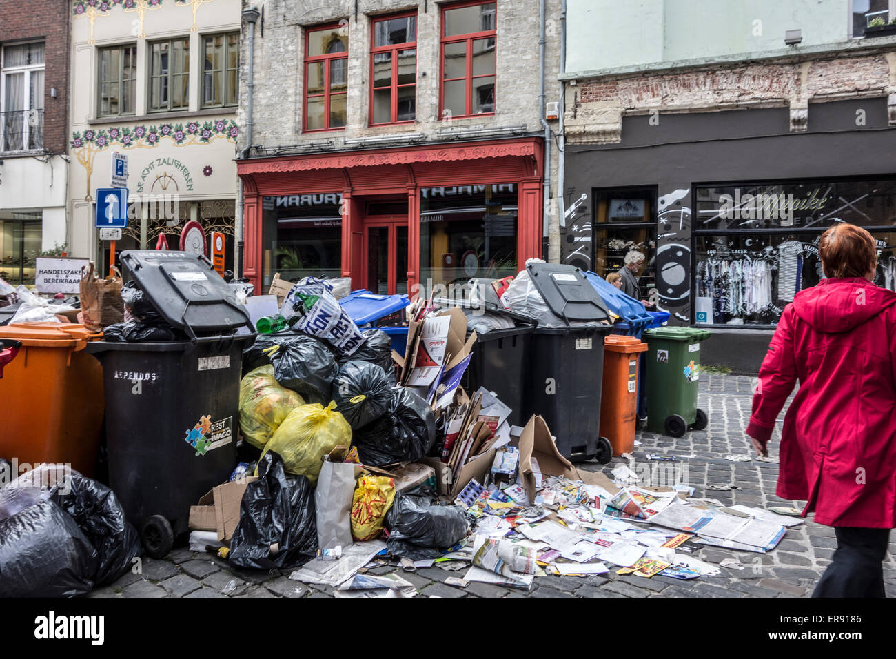 Rubbish bags and garbage containers with piled up household refuse due to strike of binmen in the city Ghent, Belgium - Stock Image