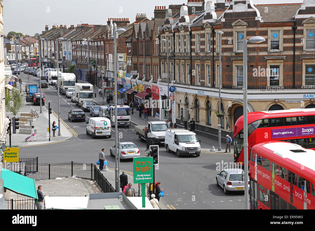 Lee Bridge Road, a busy suburban high street in North London showing traffic congestion, buses and pedestrians - Stock Image
