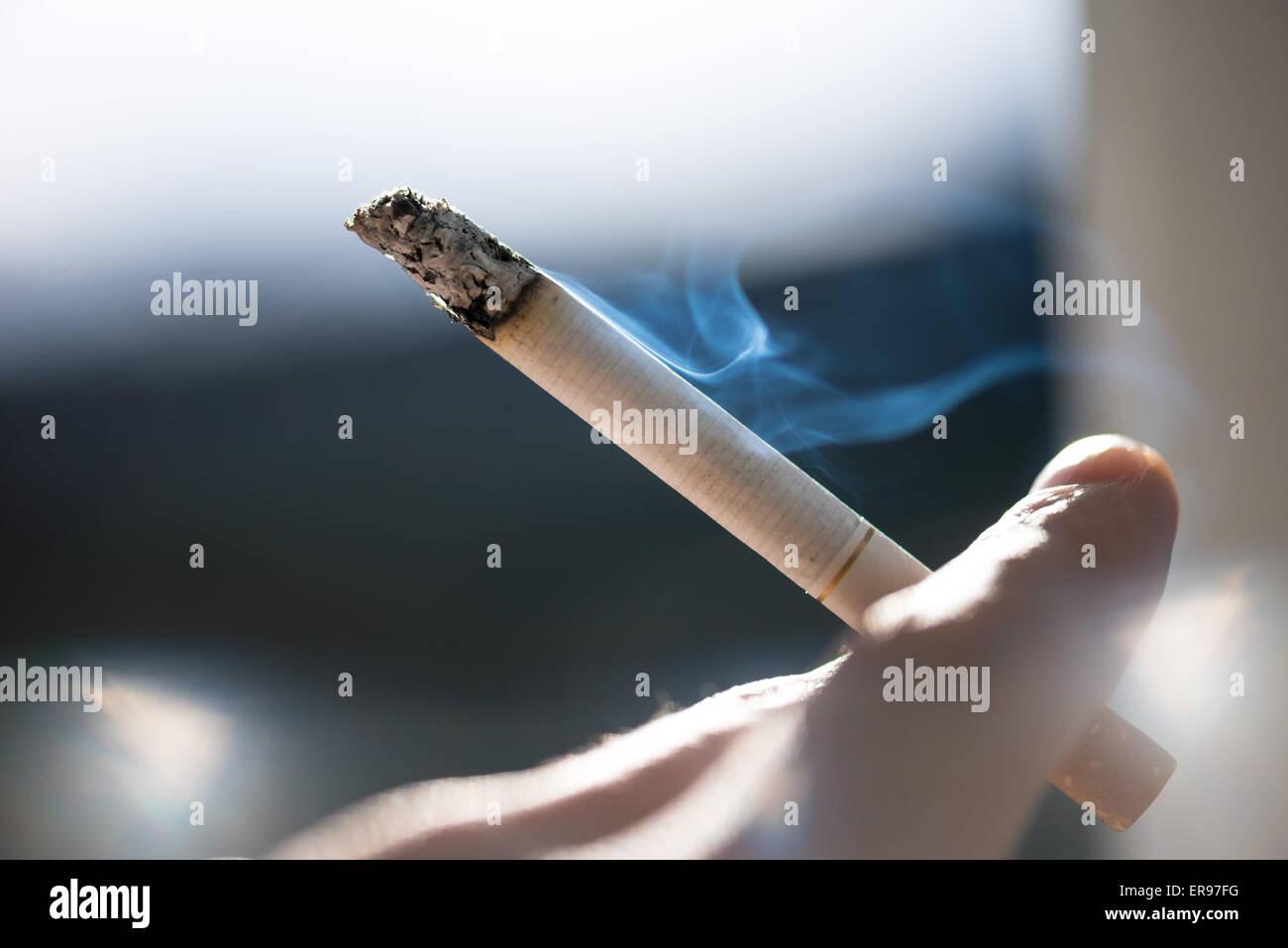 cigarette smoking - Stock Image