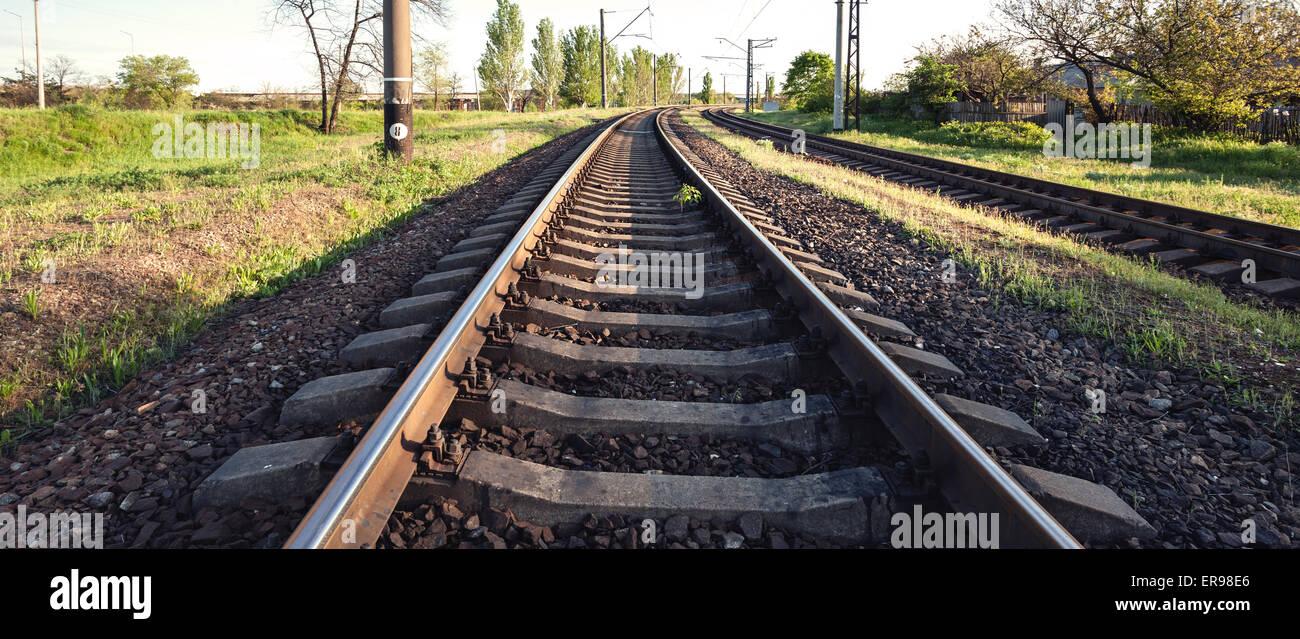 Cargo train platform at sunset. Railroad in Ukraine. Railway station - Stock Image