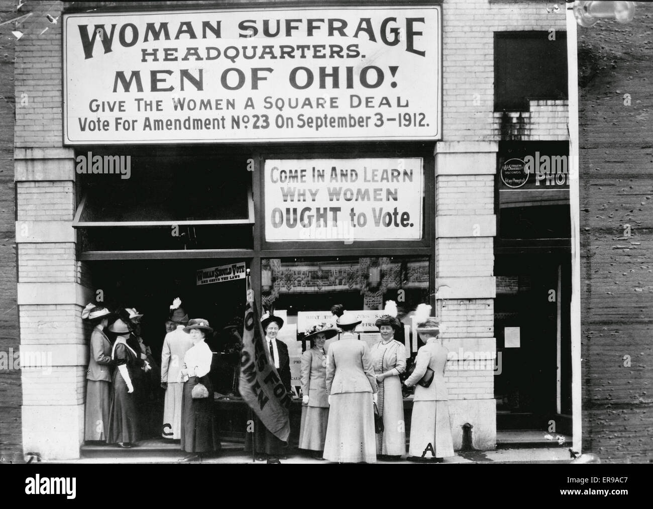 Woman suffrage headquarters in Upper Euclid Avenue, Cleveland - A. (at extreme right) is Miss Belle Sherwin, President, National League of Women Voters; B. is Judge Florence E. Allen (holding the flag); C. is Mrs. Malcolm McBride. 1912 Stock Photo