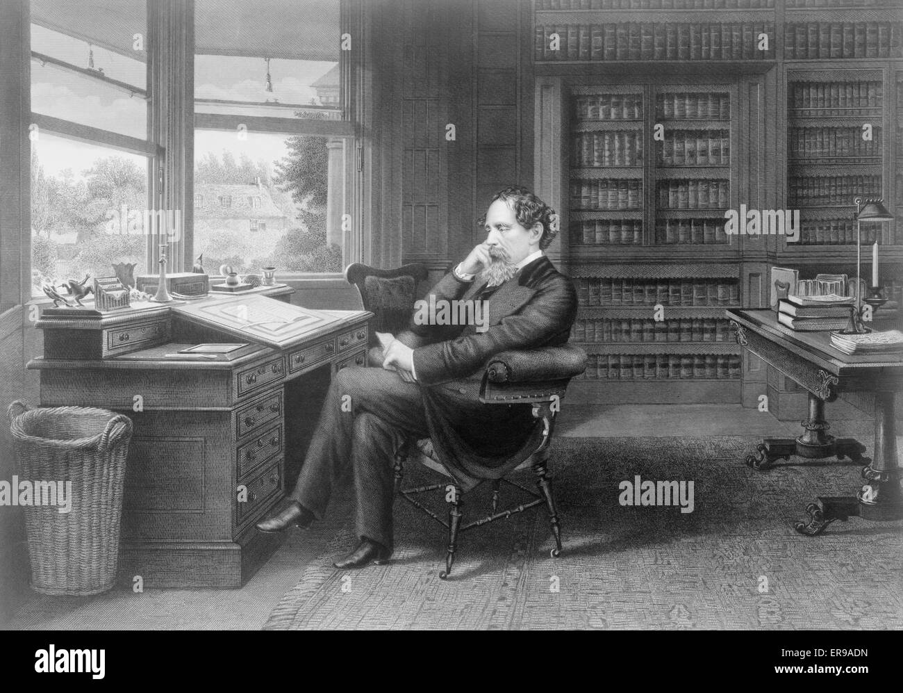 Charles Dickens in his study at Gadshill. Charles Dickens, full-length portrait, seated at desk, facing left, in - Stock Image