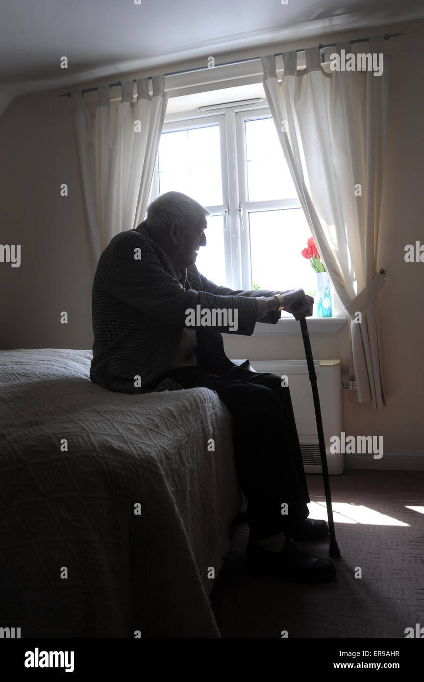 Silhouetted old age pensioner re loneliness lonely oap retirement depression man men depressed alone care home elderly uk cry