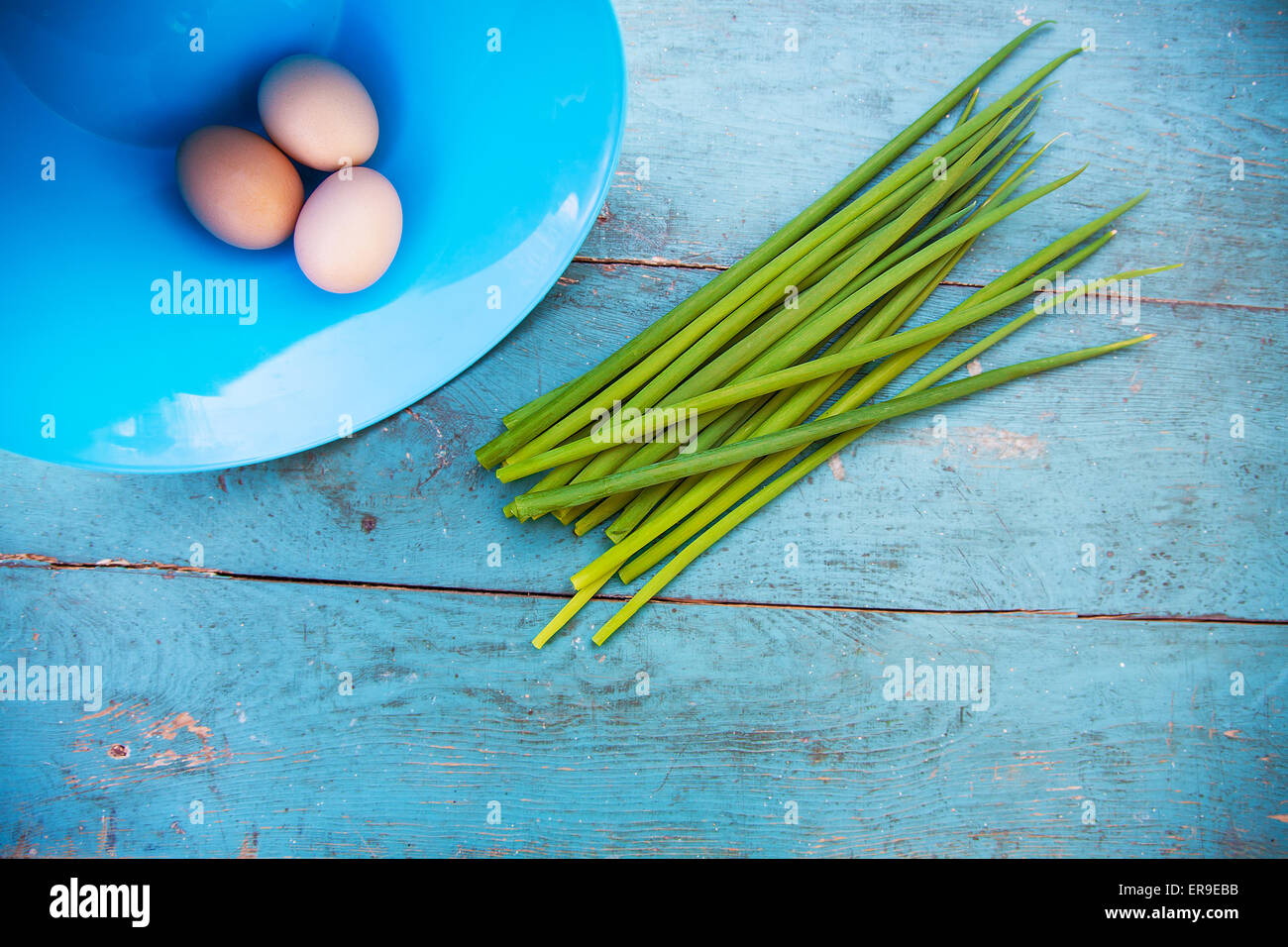 Natural white eggs in a blue bowl - Stock Image