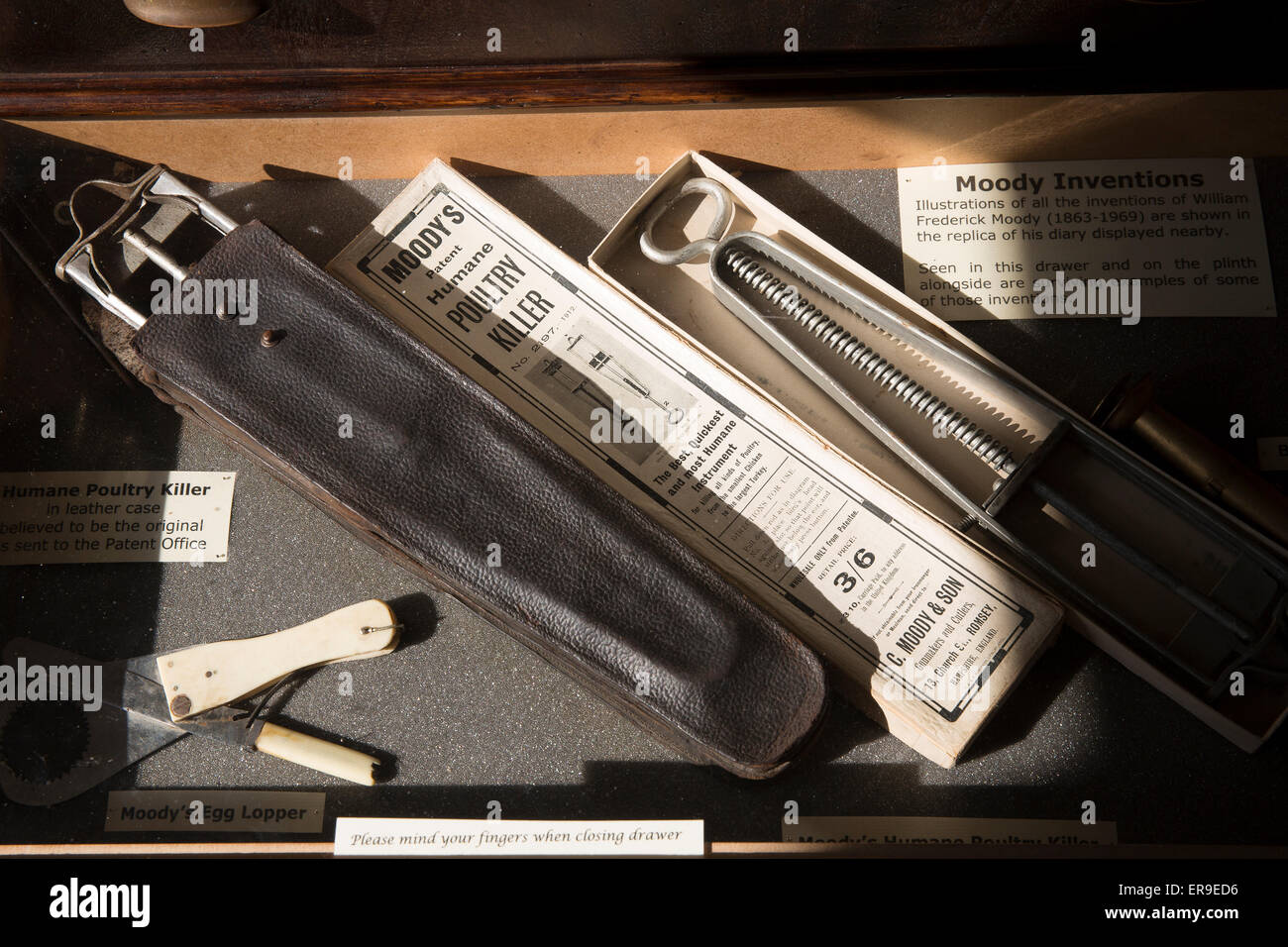Moody's Humane Poultry Killer, William Moody's Gun and Fishing Shop, Romsey Museum, Hampshire, England, - Stock Image