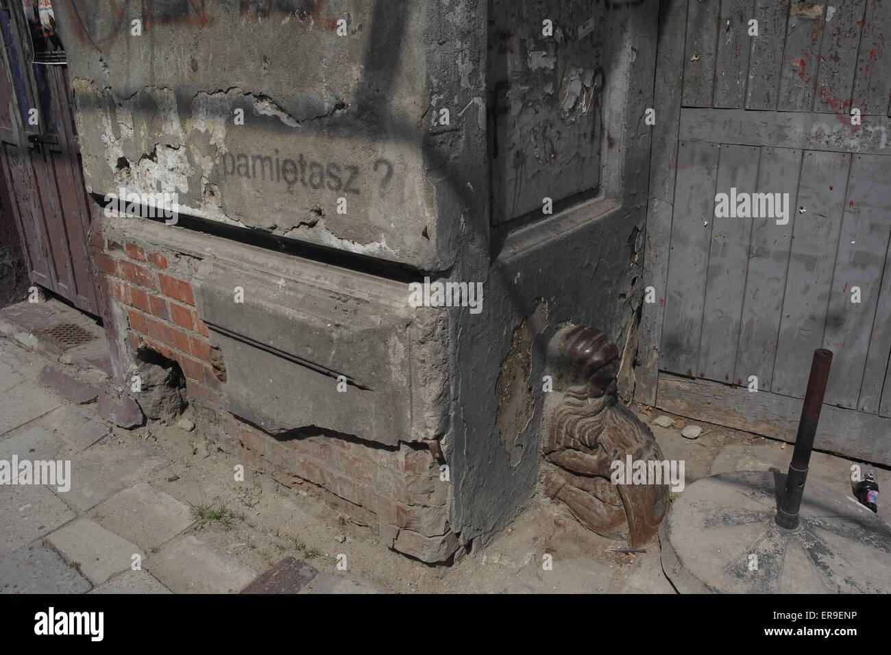 Door post butt in shape of elderly man with flowing beard foot of wall to the side of a door pre-war 14 Prozna Street Warsaw & Door post butt in shape of elderly man with flowing beard foot of ...