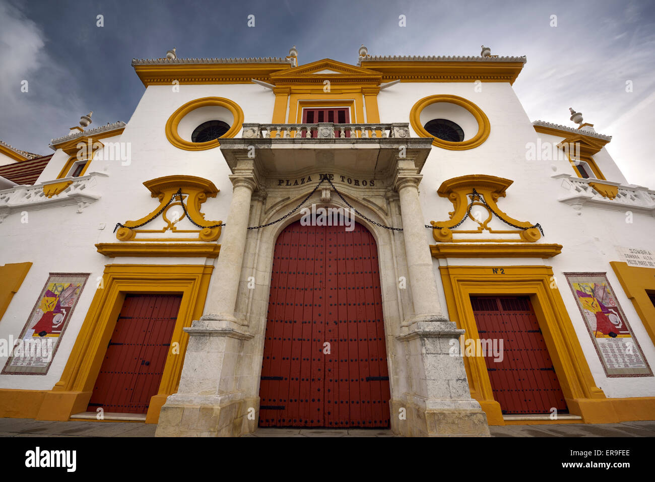 Front doors and baroque facade of the Plaza de Toros Bull fighting ring in Seville Spain - Stock Image