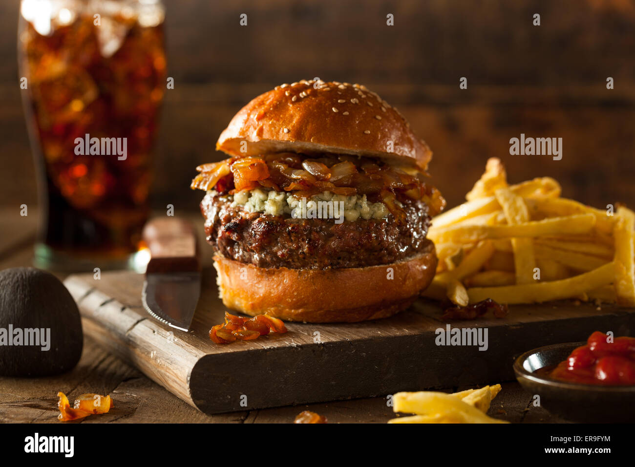 Juicy Blue Cheese Hamburger with Onions and Bacon - Stock Image