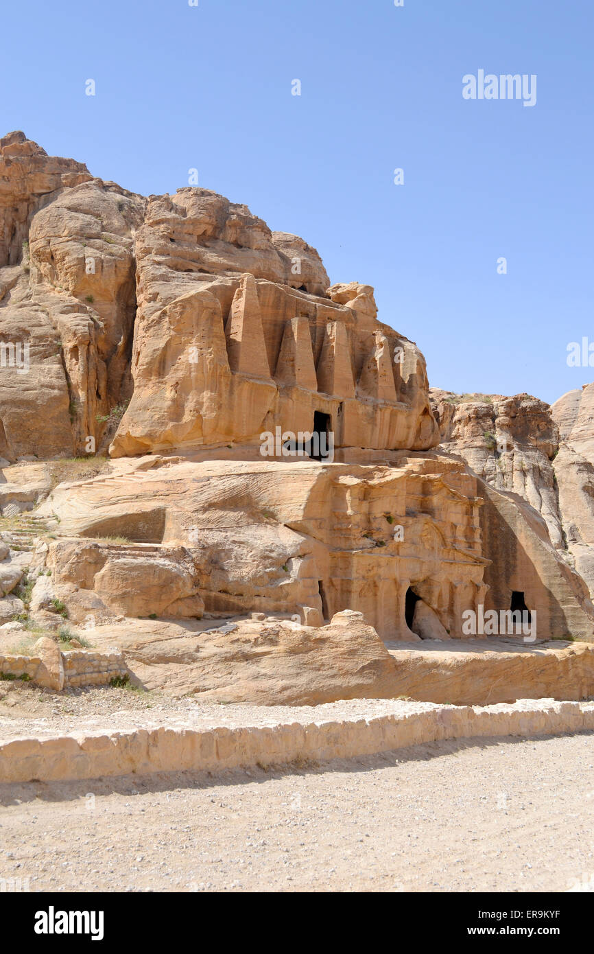 Nabataean caves & sculptures on the way to the ancient city of Petra. - Stock Image