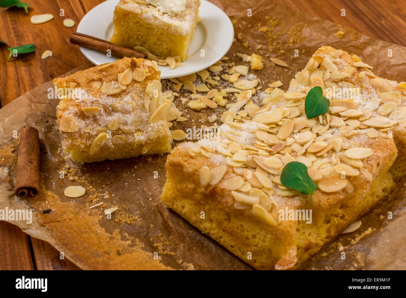 Almond dessert with sugar and mint leaf on wood table Stock Photo