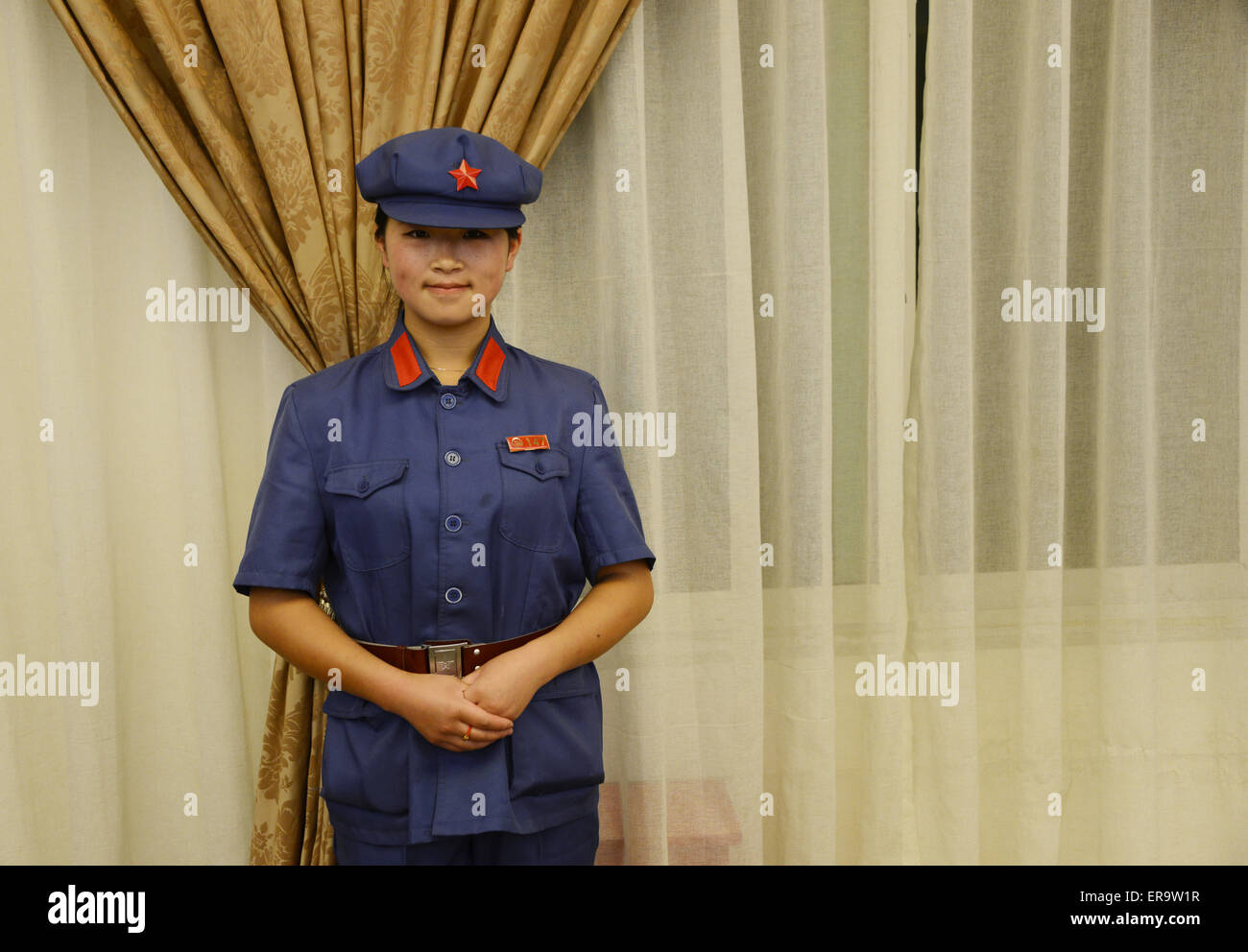 Sichuan, China. 29th May, 2015. A narrator with Red Army cloths stands at a Red Army Long March Museum in Luding - Stock Image