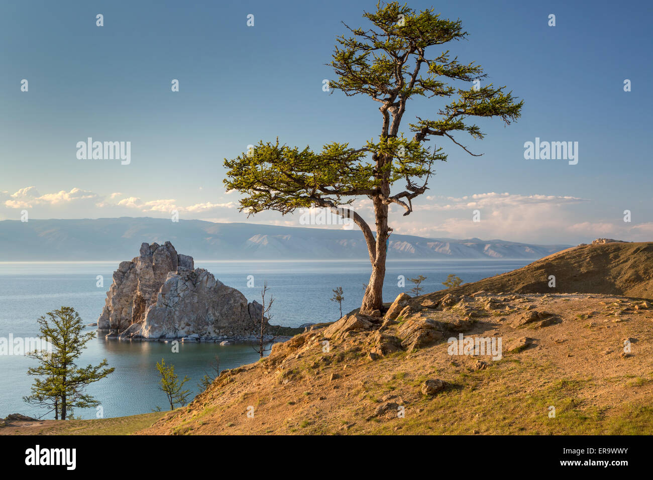 View of coast of Baikal lake, Shaman rock, the tree of desires and cape Burhan on Olkhon Island, Russia - Stock Image