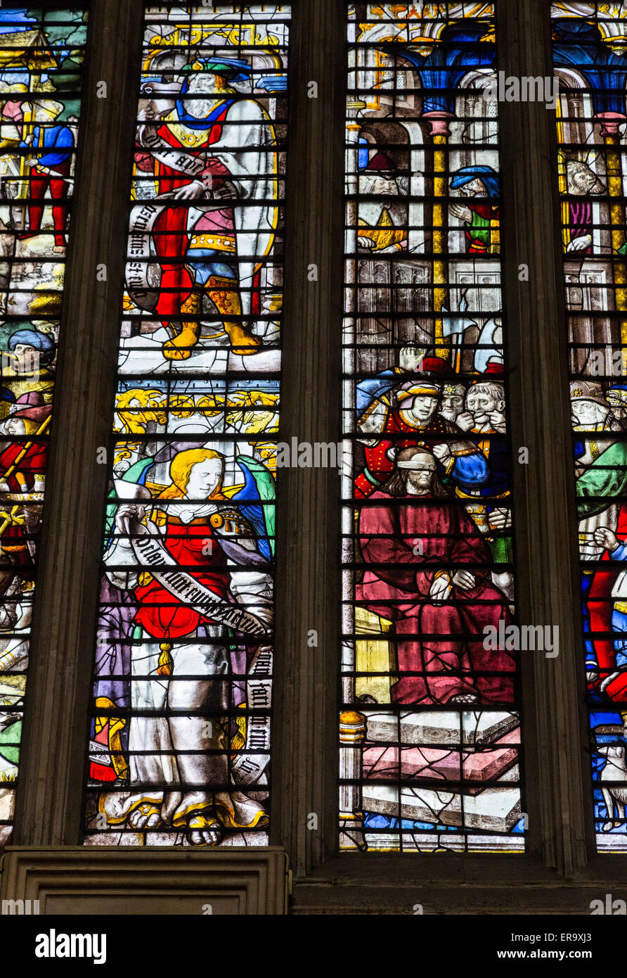 UK, England, Cambridge.  King's College Chapel, 16th.-century Stained Glass Window showing the Mocking of Christ. - Stock Image