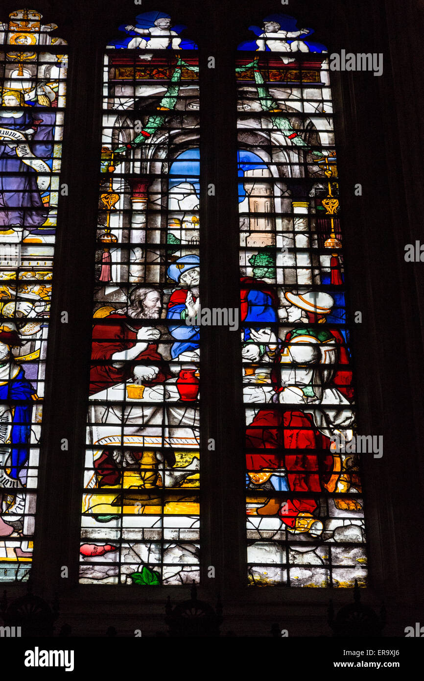 UK, England, Cambridge.  King's College Chapel, 16th.-century Stained Glass Window showing the Supper at Emmaus. - Stock Image