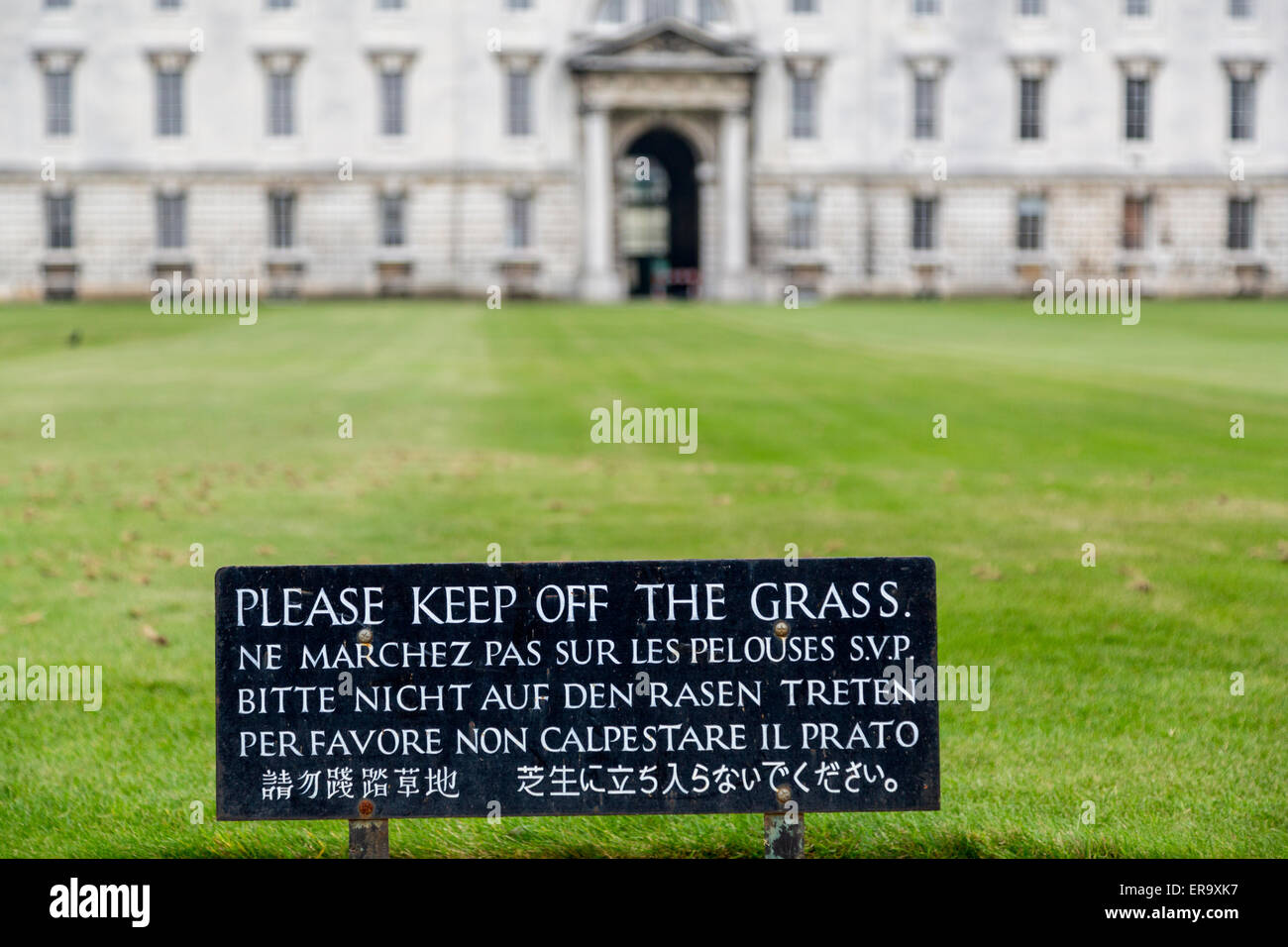 England, Cambridge.  Multilingual Sign in English, French, German, Italian, Chinese, and Japanese:  Please Keep - Stock Image