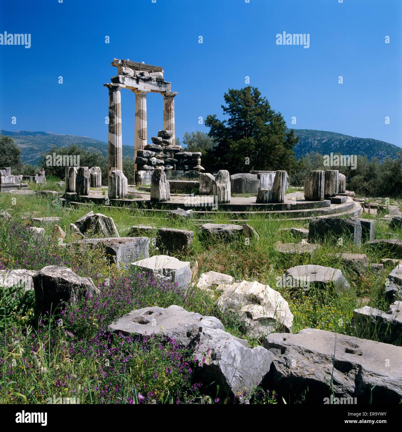 The Tholos below Mount Parnassus, Delphi, Phocis, Central Greece, Greece, Europe Stock Photo