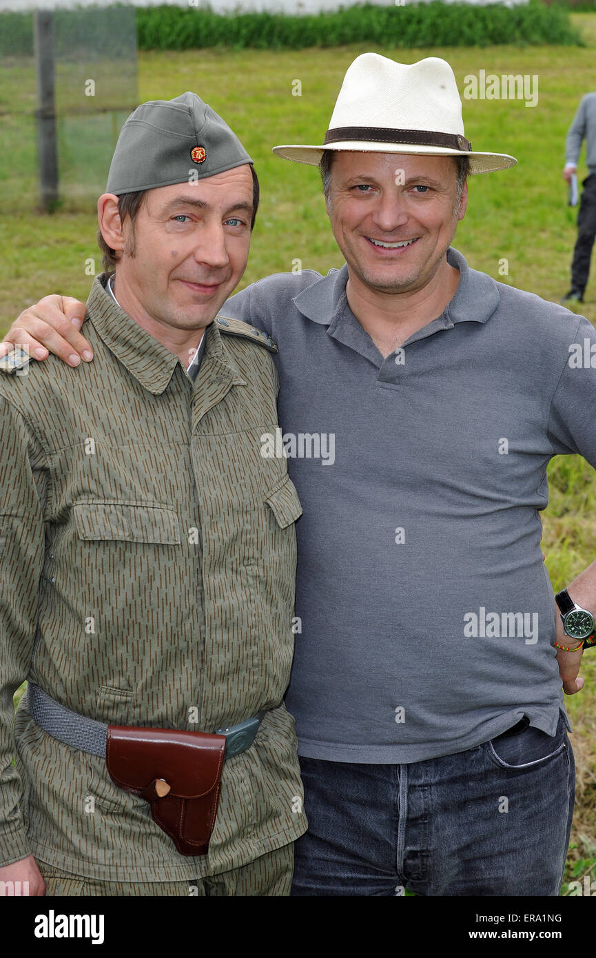 Gerolsbach, Germany. 29th May, 2015. Actor Thorsten Merten (L), who plays GDR National People's Army soldier Ralle Stock Photo