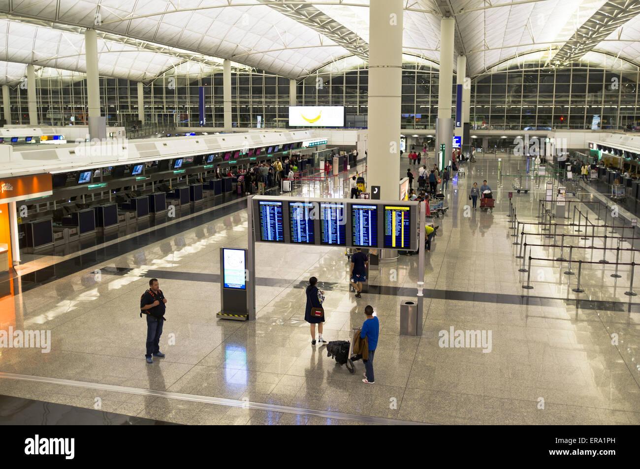 dh Hong Kong airport CHEK LAP KOK HONG KONG Check in desk departure board - Stock Image