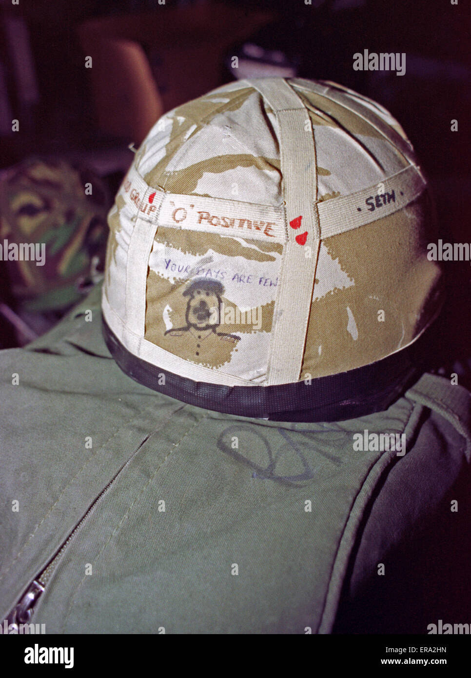 """Late Jan. 1991. A cartoon of Saddam with the caption """"Your days are few"""" on a British soldier's helmet on board - Stock Image"""