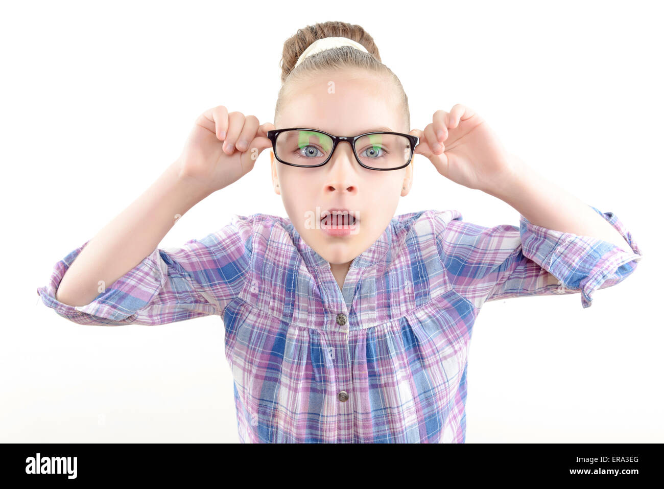 Small girl wearing glasses - Stock Image
