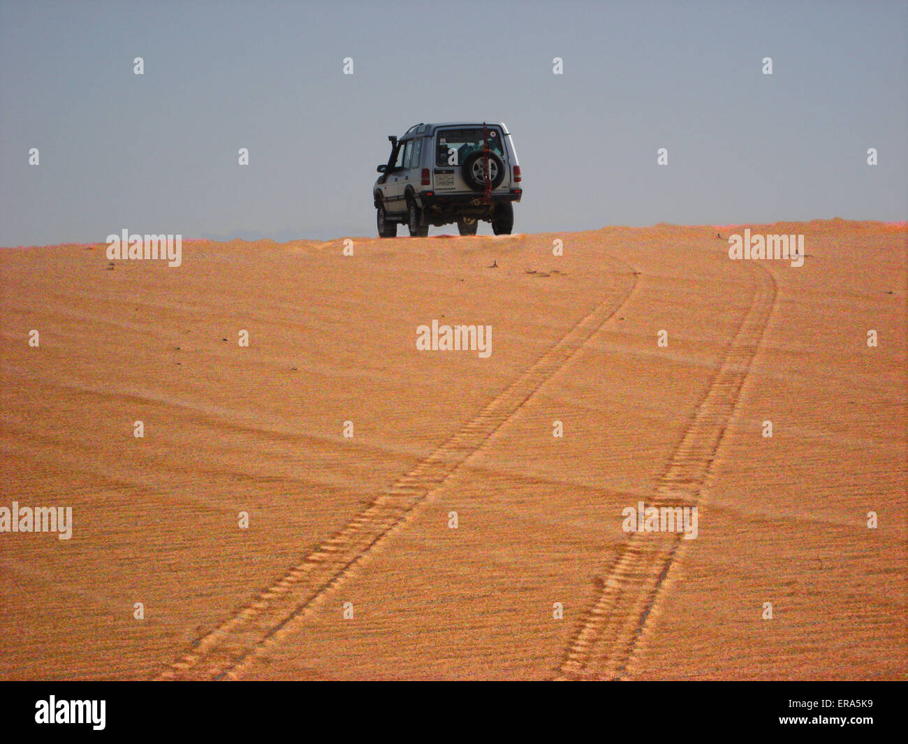 A Landrover on a sand dune in the inland sea Qatar - Stock Image