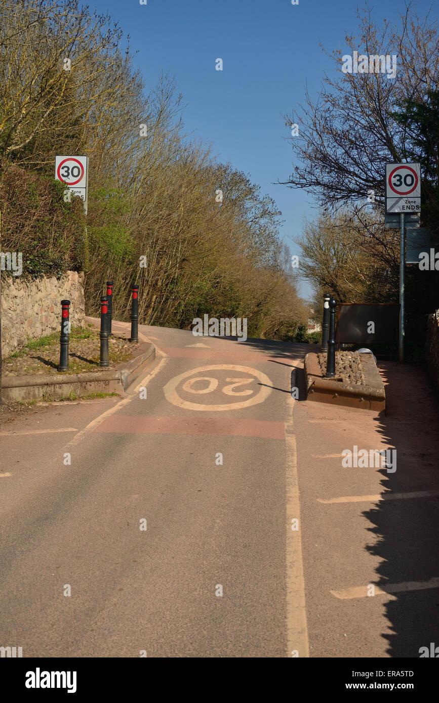 Traffic calming measures along narrow village road. - Stock Image