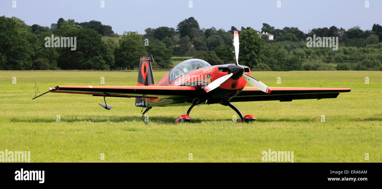 Blade 4 -  Extra EA-300 of the Blades Aerial display team, Cosford, Shropshire, England, Europe - Stock Image