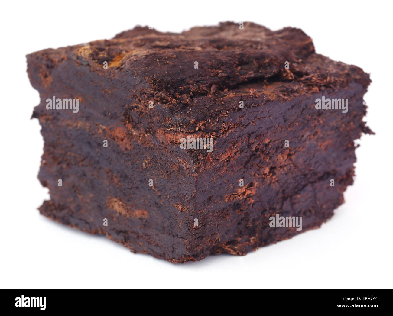 Close up of peat block over white background - Stock Image
