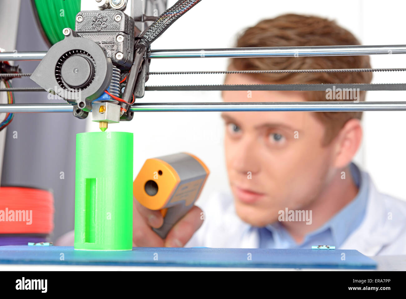 Scientist working with three-dimensional  printer - Stock Image