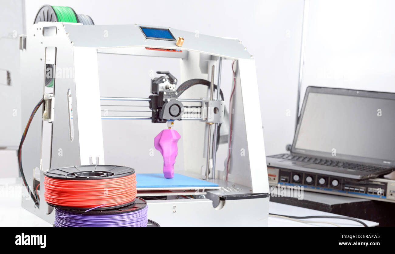 Three-dimensional printer during work - Stock Image