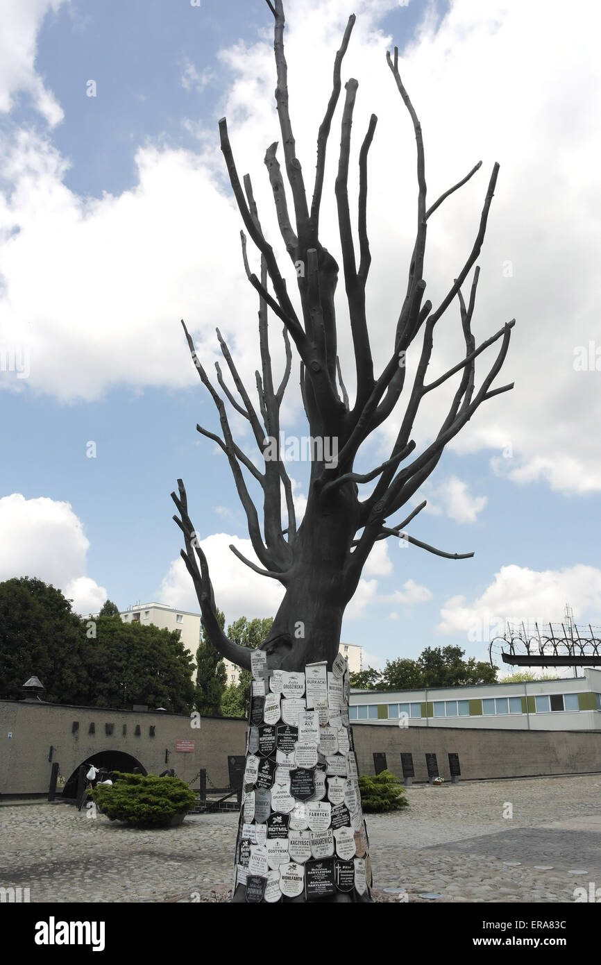 Blue sky white clouds portrait bronze memorial tree with obituary plaques Gestapo victims, Pawiak Prison Museum, Stock Photo