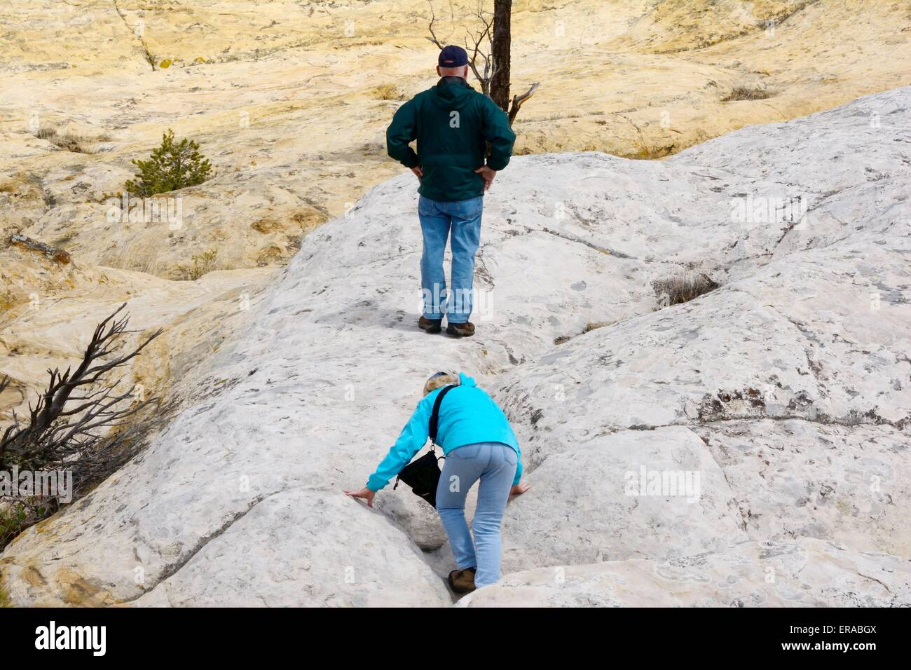 Brother waiting for sister on sandstone bluff El Morro National Monument New Mexico - USA - Stock Image