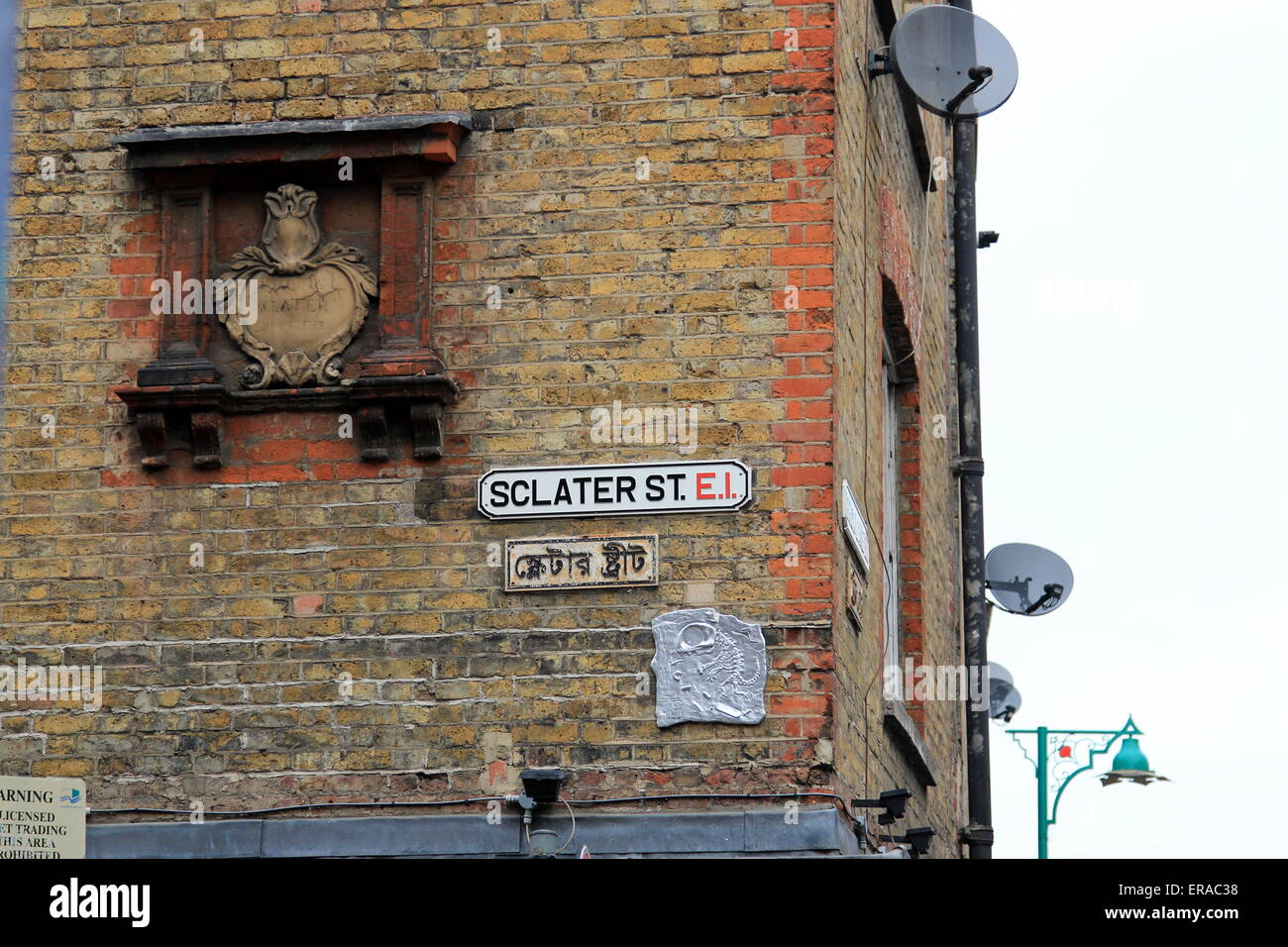 Sclater St street sign on brickwall Stock Photo