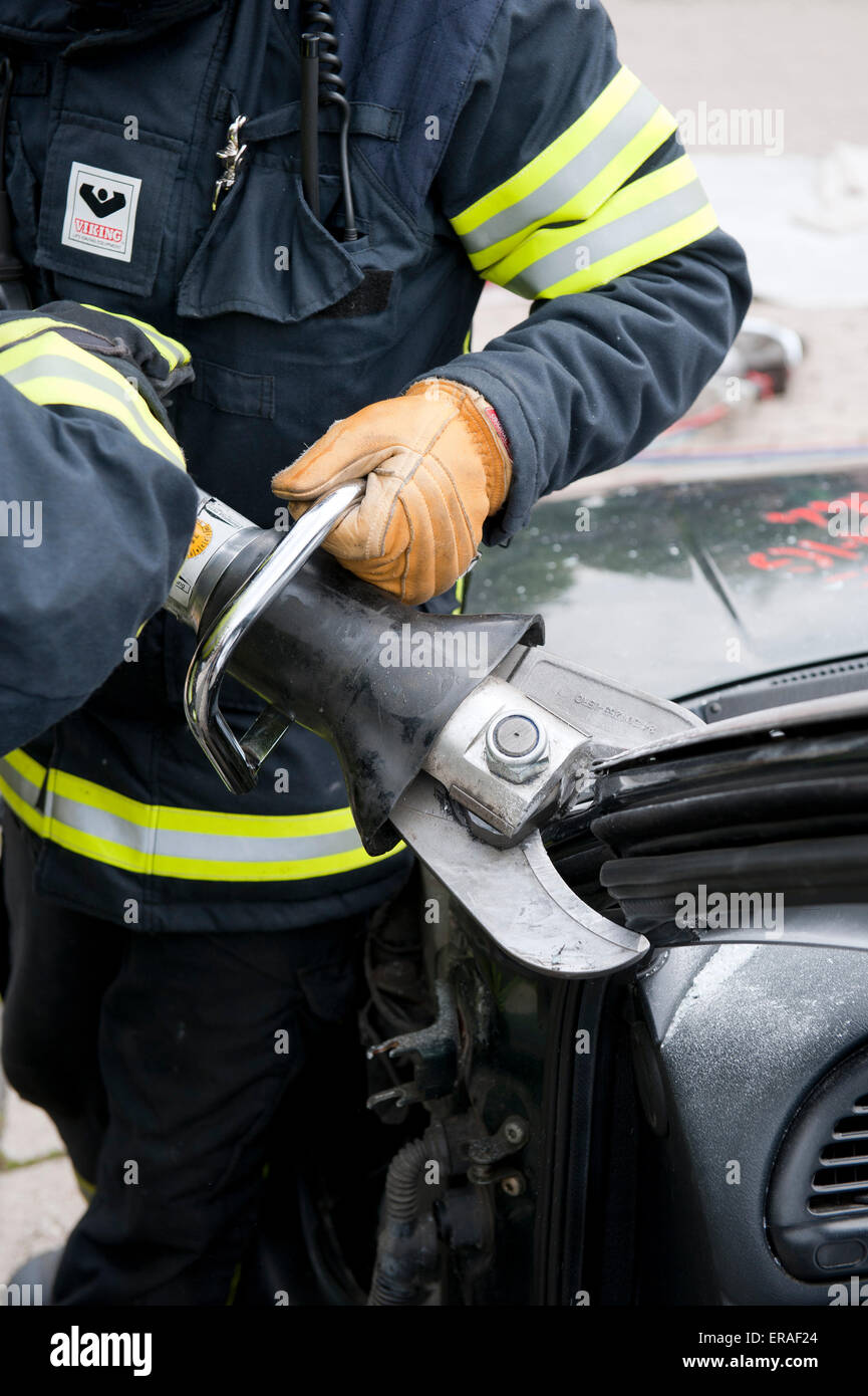 Rescue operation of the fire brigade on a car Germany - Stock Image