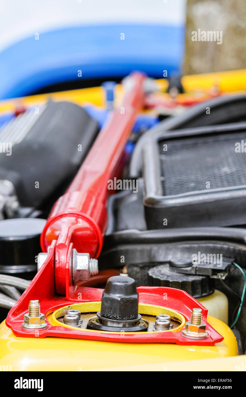 Brace bar fitted to the Macpherson struts in a high performance tuned car. - Stock Image