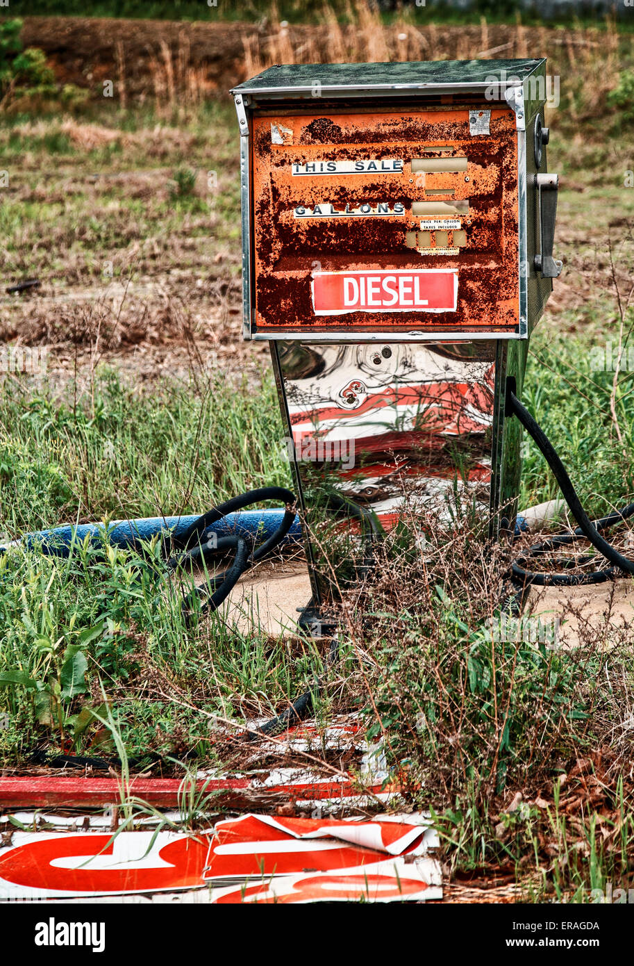 Gutted diesel pump at an abandoned gas station and restaurant. - Stock Image