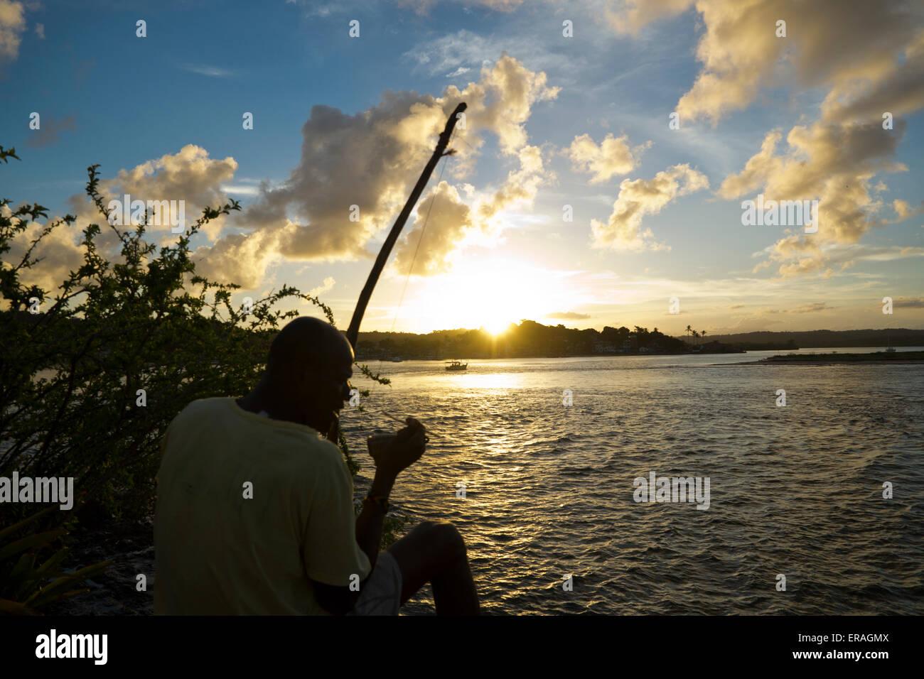 Man playing Berimbau at Itacaré, Bahia, Brazil Stock Photo