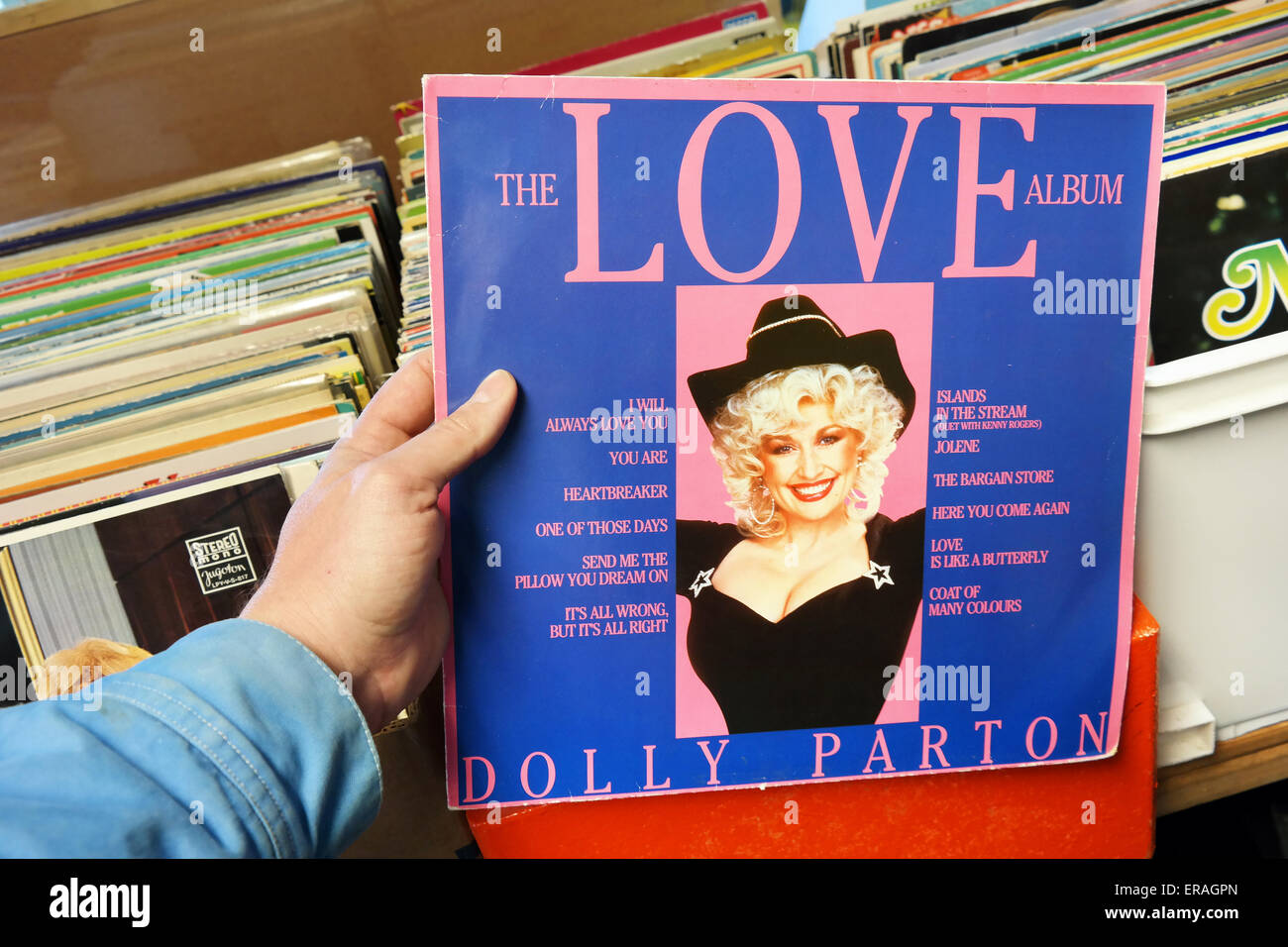 THE NETHERLANDS - MARCH 2015: LP record of the American singer-songwriter Dolly Parton in a second hand store. - Stock Image