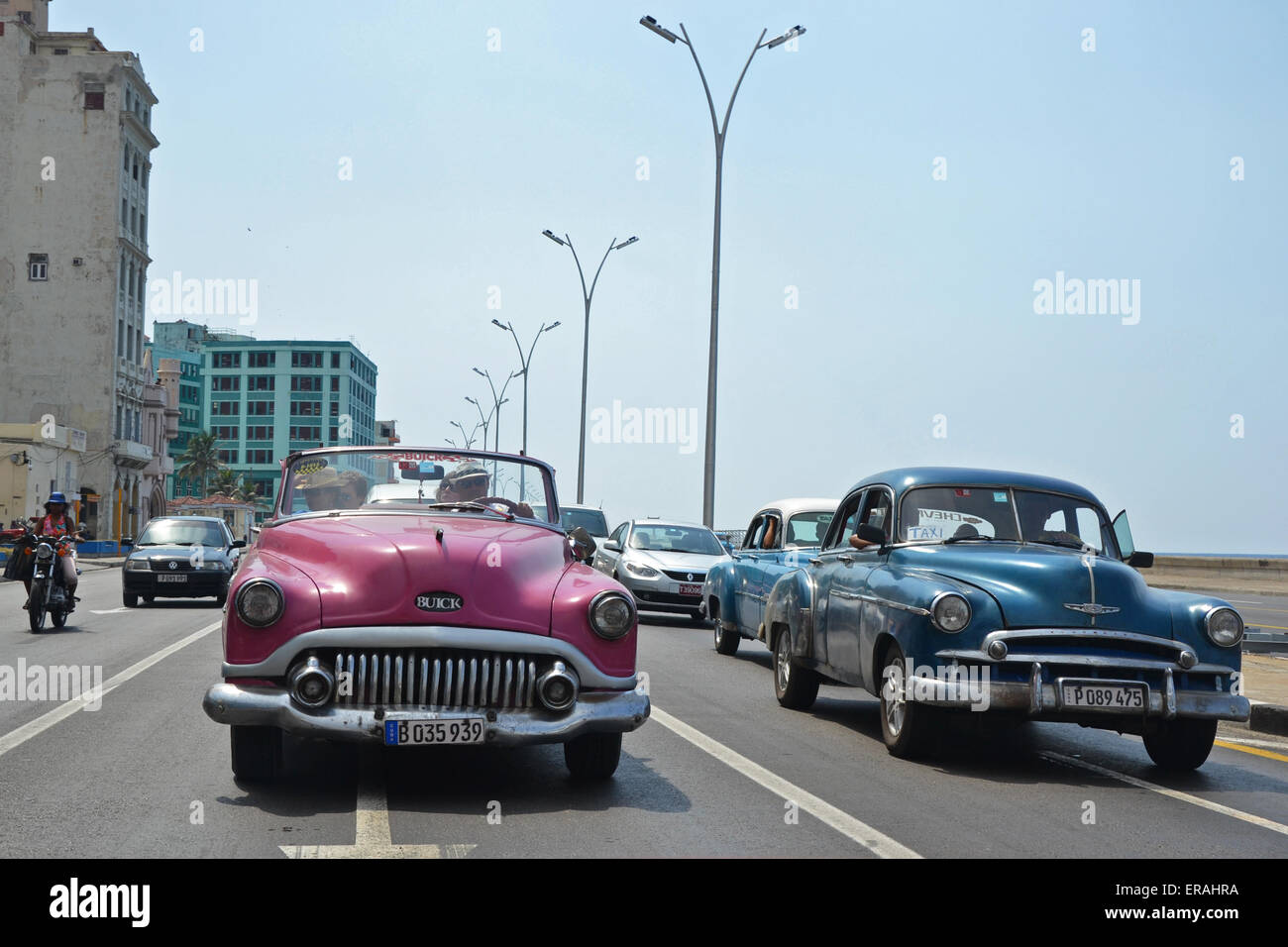 Havana - July 18: American classic cars driving along the famous ...