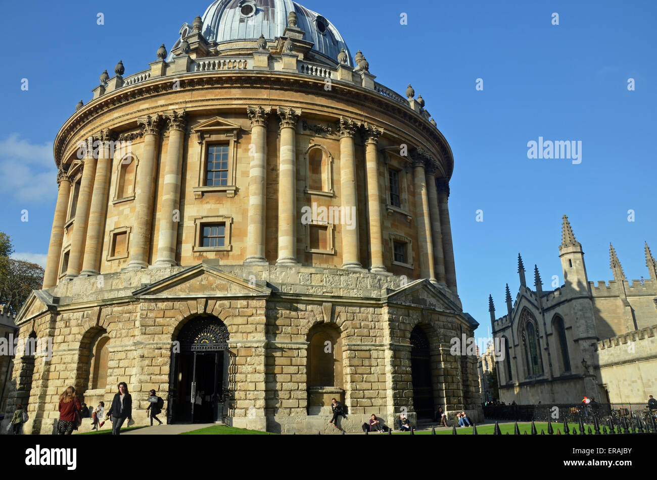 Oxford, UK - October 27, 2014: view of the Radcliffe Camera with All Souls College in Oxford, UK. The historic building - Stock Image