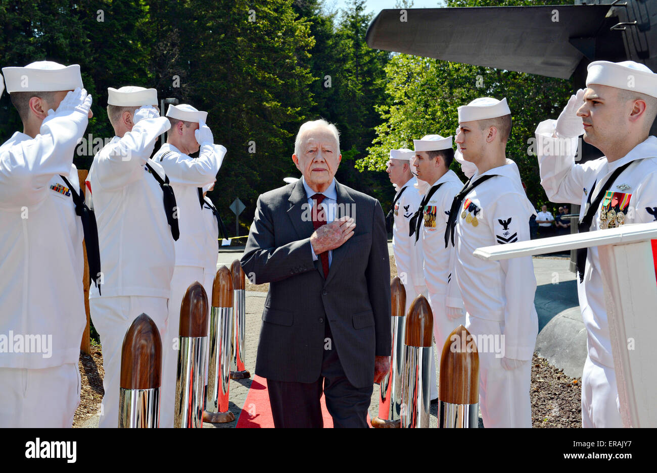 Former U.S. President Jimmy Carter is piped aboard during his arrival at the change of command ceremony for Seawolf - Stock Image