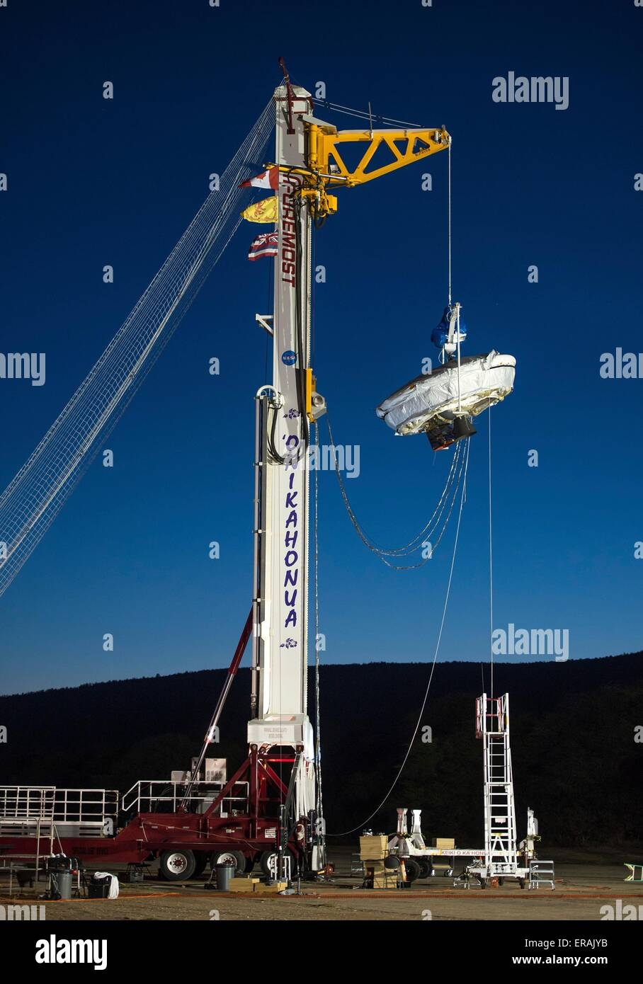 The Low-Density Supersonic Decelerator is lifted into position for a full mission dress rehearsal at the U.S. Navy - Stock Image