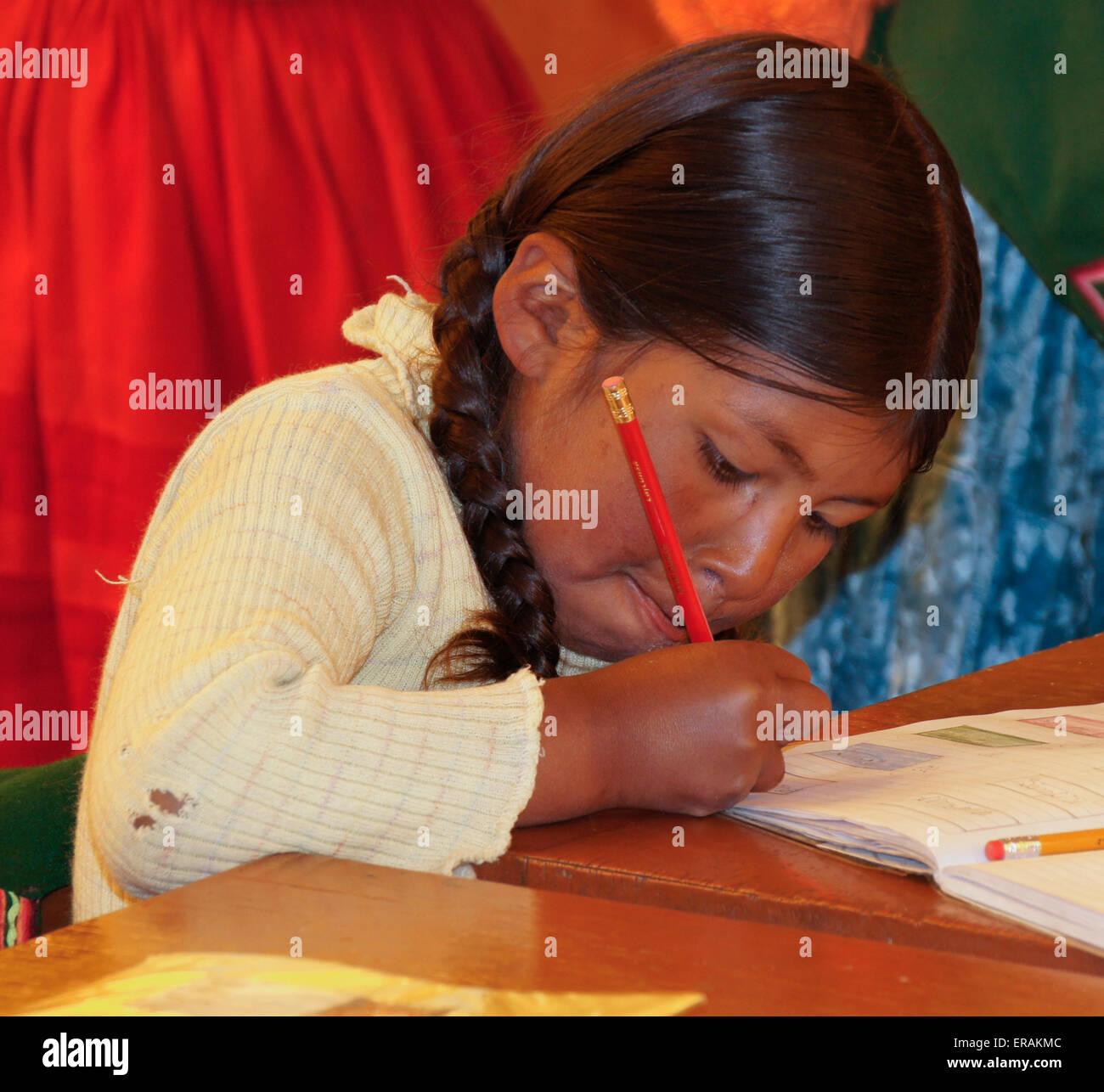 Young Uros Indian girl in classroom, Lake Titicaca, Puno, Peru - Stock Image