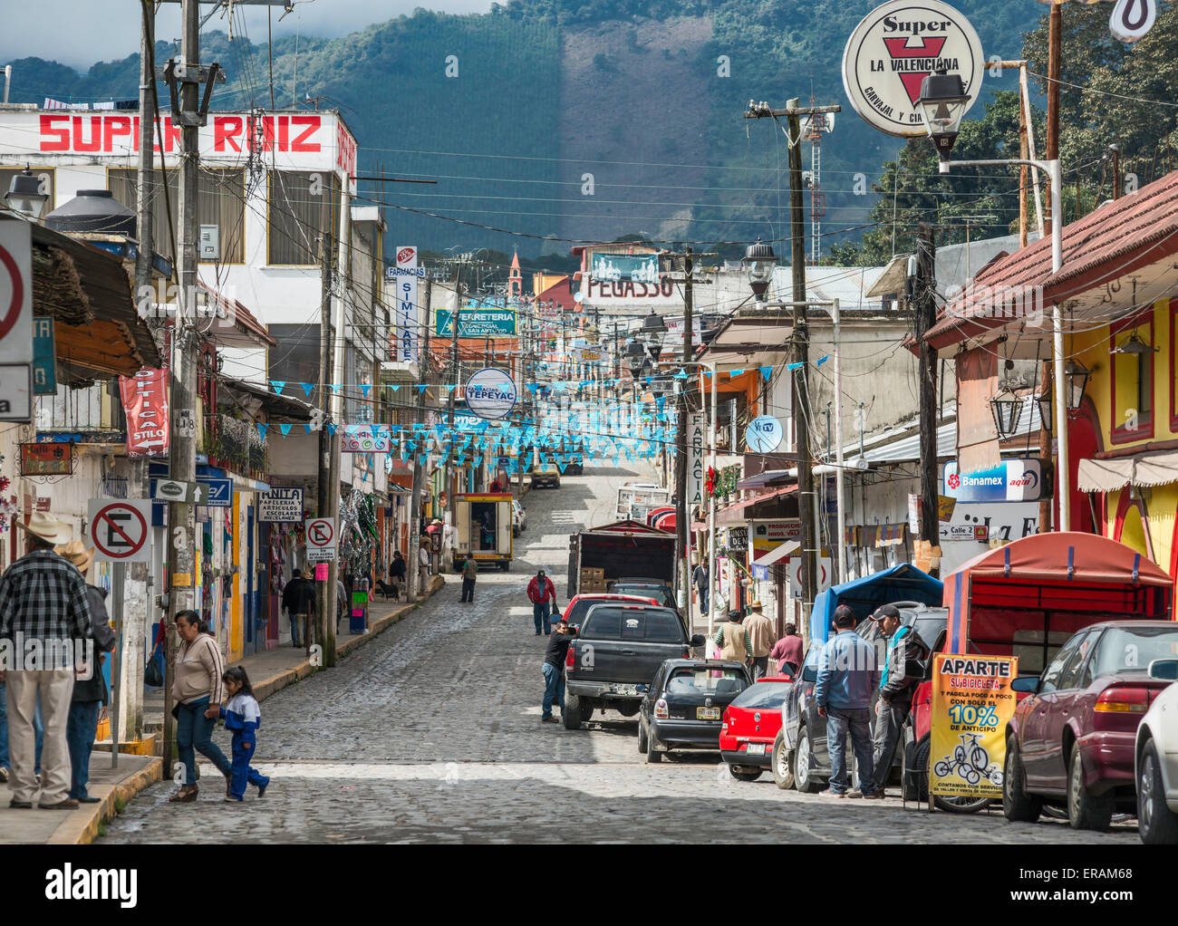 Avenida Nicholas Bravo, cobbled street with utility cables overhead, decorated with pennants, in Coscomatepec, Veracruz, - Stock Image