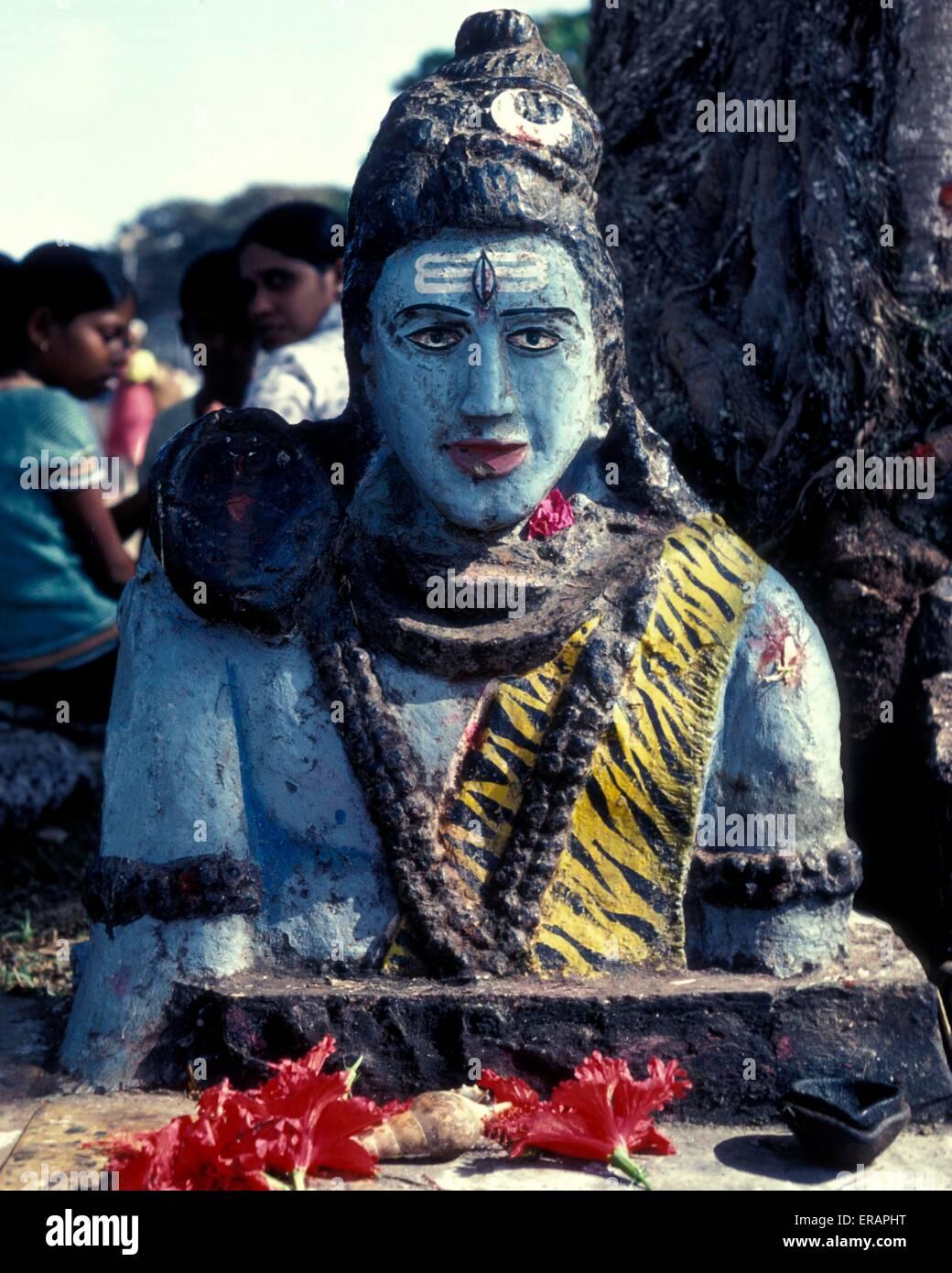 A statue of Lord Krishna on a roadside in Goa - Stock Image