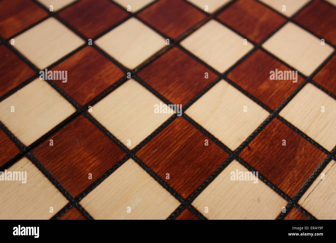 Background in a cage. Chessboard - Stock Image