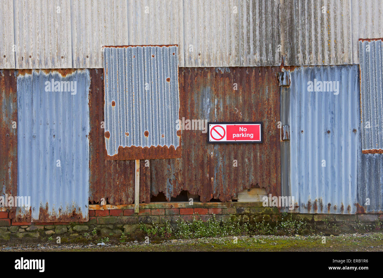 No Parking sign on wall, UK - Stock Image