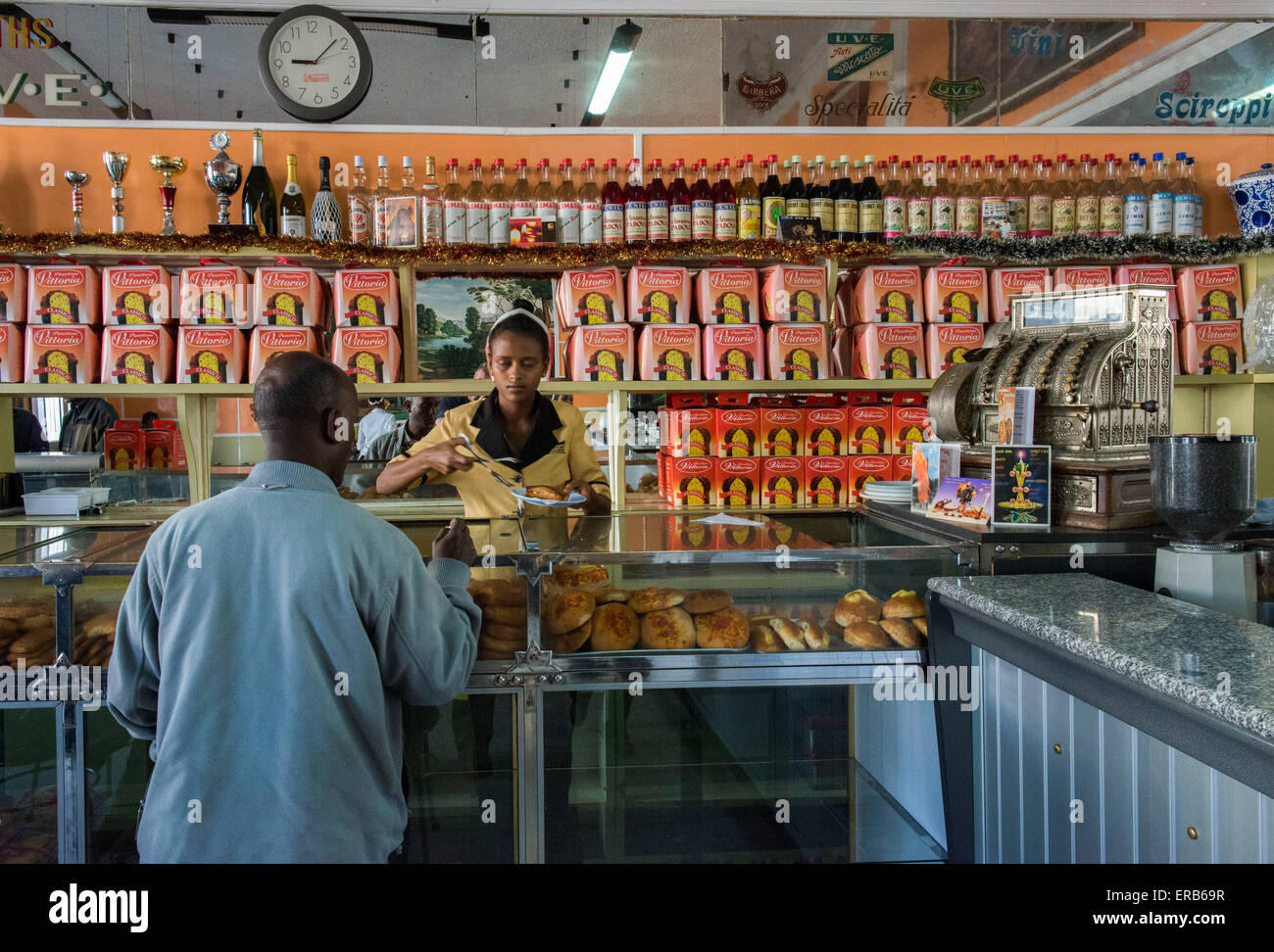 Man Buying Pastries For Brekfast In A Café, Asmara - Stock Image
