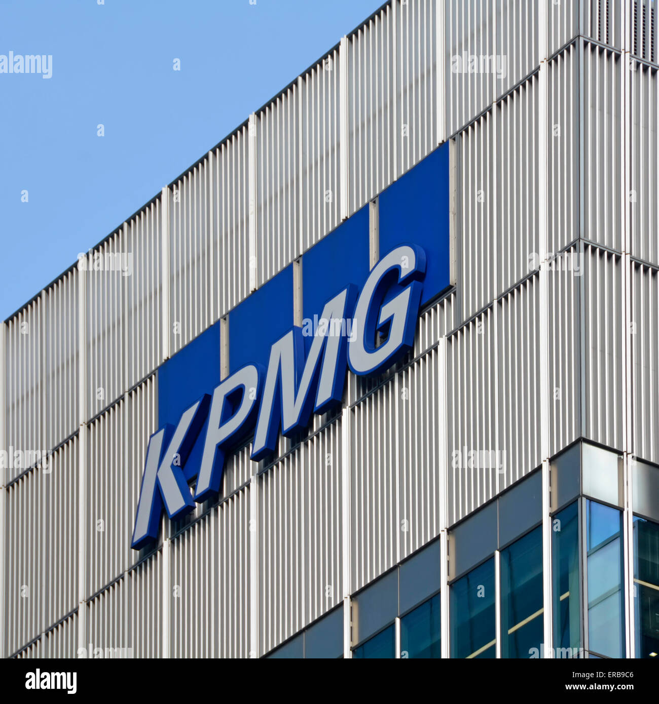 KPMG roof level sign on office building in Canary Wharf London England UK - Stock Image