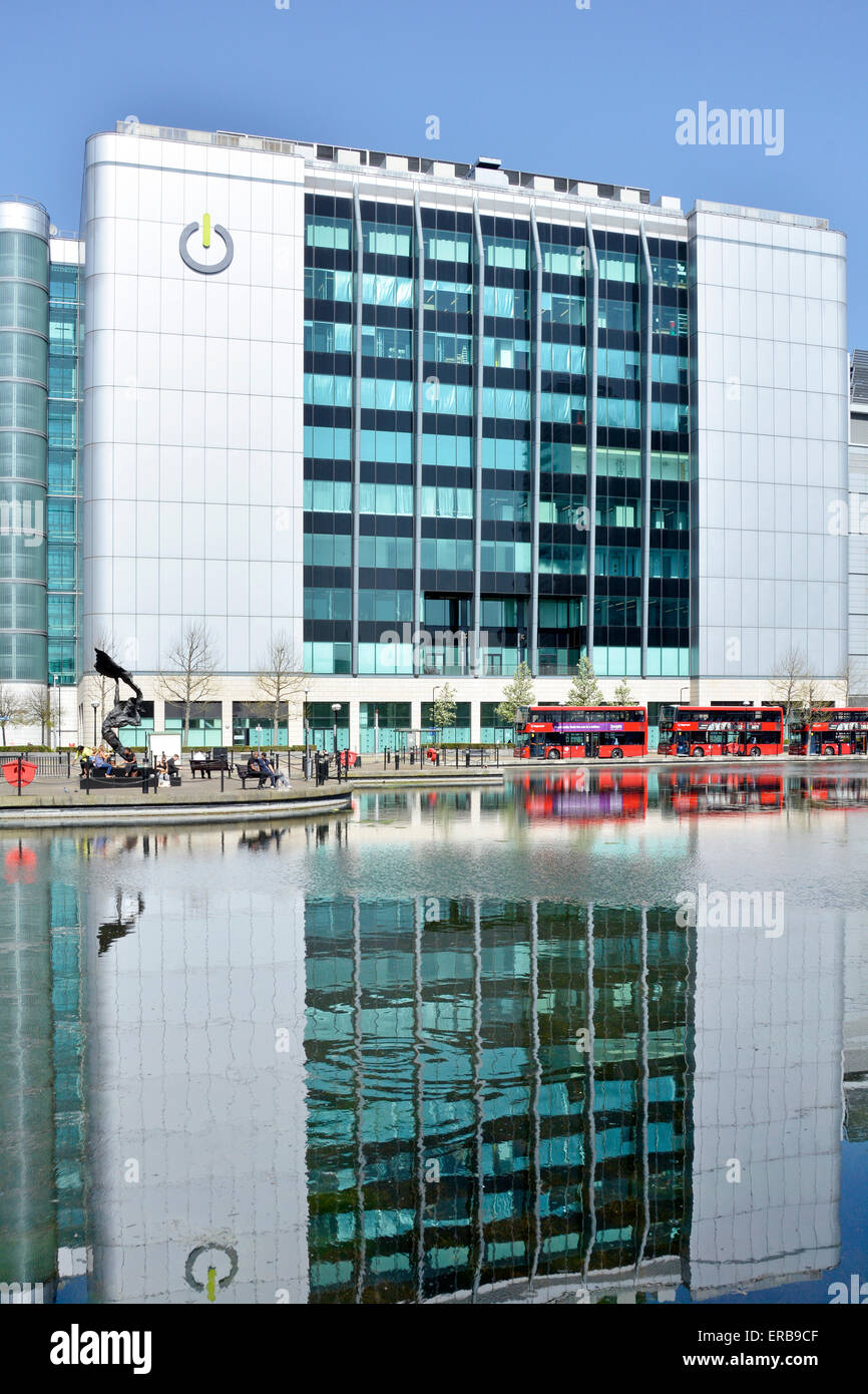 Offices of Global Switch data centre provider reflections in landscaped water feature bus stands Tower Hamlets East - Stock Image